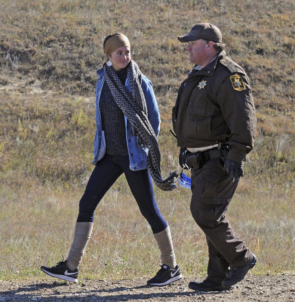 Actress Shailene Woodley is led to a transport vehicle by a Morton County Sheriff's deputy after being arrested at a protest against the Dakota Access Pipeline near St. Anthony, N.D., Monday, Oct. 10, 2016. The U.S. Army Corps of Engineers won't yet authorize construction of the $3.8 billion, four-state Dakota Access oil pipeline on federal land in southern North Dakota, it said Monday, along with reiterating its earlier request that the pipeline company voluntarily stop work on private land in the area. (Tom Stromme/The Bismarck Tribune via AP)