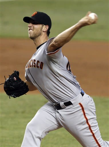 San Francisco Giants starting pitcher Madison Bumgarner throws in the third inning during a baseball game against the Miami Marlins in Miami, Saturday, May 26, 2012. (AP Photo/Lynne Sladky)