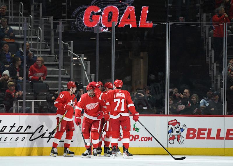Detroit Red Wings center Robby Fabbri (14) celebrates his goal with teammates during the first period against the Winnipeg Jets at Little Caesars Arena, Dec. 12, 2019, in Detroit.