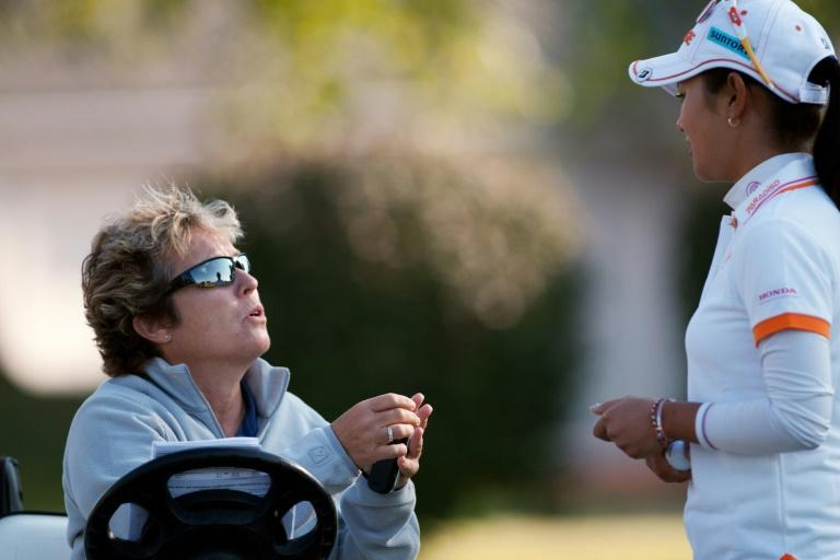 LPGA rules official Sue Witters (L) talks to a golfer during a tournament in Rogers, Arkansas