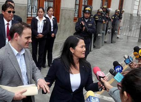 Keiko Fujimori, daughter of former president Alberto Fujimori and leader of the opposition in Peru, accompanied by her husband Mark Vito leaves the court after a hearing as part of an investigation into money laundering, in Lima, Peru October 24, 2018. REUTERS/Guadalupe Pardo
