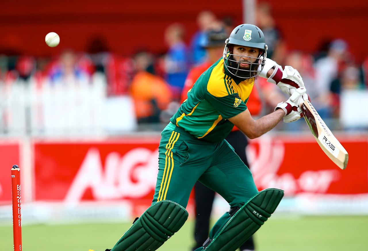 PORT ELIZABETH, SOUTH AFRICA - NOVEMBER 27: Hashim Amla of South Africa during the 2nd One Day International match between South Africa and Pakistan at AXXESS St Georges on November 27, 2013 in Port Elizabeth, South Africa. (Photo by Richard Huggard/Gallo Images)