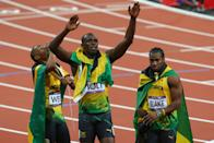 LONDON, ENGLAND - AUGUST 09: Gold medalist Usain Bolt (C) of Jamaica celebrates with silver medalist Yohan Blake (R) of Jamaica and bronze medalist Warren Weir (L) of Jamaica after the Men's 200m Final on Day 13 of the London 2012 Olympic Games at Olympic Stadium on August 9, 2012 in London, England. (Photo by Alex Livesey/Getty Images)