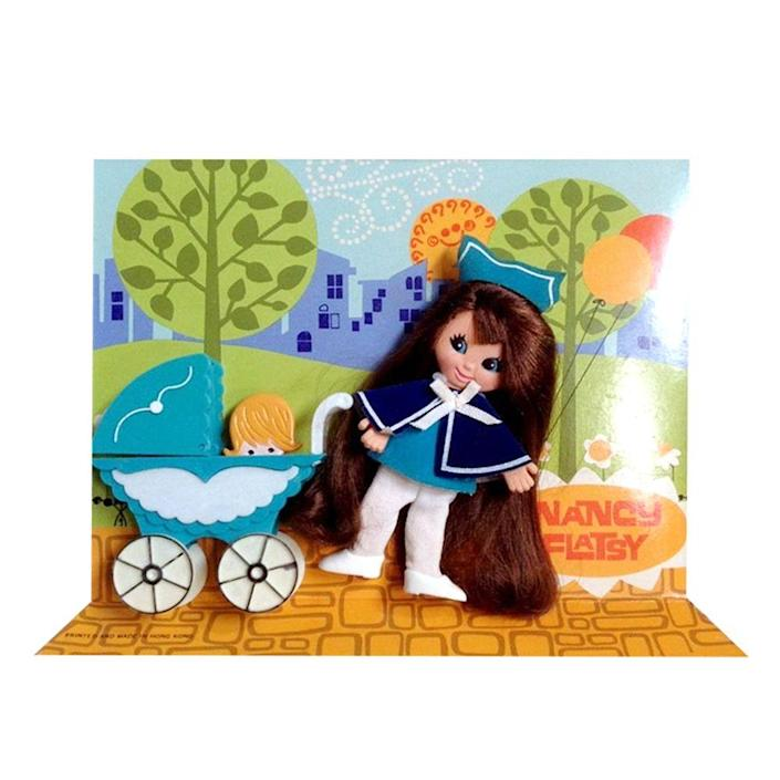 """<p><a class=""""link rapid-noclick-resp"""" href=""""https://go.redirectingat.com?id=74968X1596630&url=https%3A%2F%2Fwww.etsy.com%2Flisting%2F858980422%2Fcandy-mountain-flatsy-doll-ideal-1971&sref=https%3A%2F%2Fwww.redbookmag.com%2Flife%2Fg34738490%2Fmost-popular-product-from-the-year-you-were-born%2F"""" rel=""""nofollow noopener"""" target=""""_blank"""" data-ylk=""""slk:BUY NOW"""">BUY NOW</a><br></p><p>Currently a collector's item, Flatsy Dolls were a hit when they launched in 1969. The flat dolls, which were made of vinyl, had wires in them that allowed their limbs to pose in different directions. Each Flatsy came with a themed accessory and a scene printed on cardboard. </p>"""