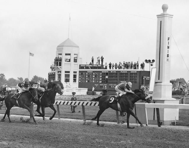 FILE - In this May 4, 1968, file photo, Dancer's Image, right, jockey Bob Ussery up, crosses the finish line to win the 94th running of the Kentucky Derby at Churchill Downs in Louisville, Ky. Forward pass, center, was second, and Francie's Hat, left, was third. Sent off as the 7-2 second choice, Dancer's Image rallied from last to win by 1 1/2 lengths over Forward Pass. The result was declared official, but Dancers Image was later disqualified after traces of phenylbutazone, known as bute, were found in Dancer's Image's post-race urinalysis. Dancer's Image was placed 14th and last; Forward Pass was declared the winner. (AP Photo/File)