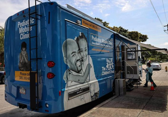 The UHealth mobile clinic parks outside Arch Creek Elementary in North Miami to provide vaccine shots to children as part of the free vaccine drives throughout Miami-Dade County. On Tuesday, May 19, 2020, the University of Miami Health System's pediatric mobile unit provided free vaccinations throughout Miami-Dade County to help keep children up-to-date in their vaccines during the COVID-19 pandemic.