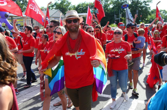 Washington Capitals goaltender Braden Holtby marches in the 2016 Capital Pride Parade.