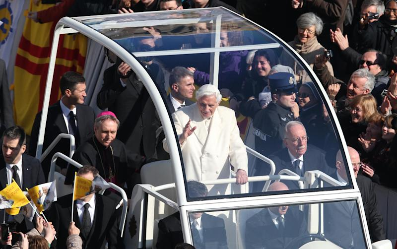 Pope Benedict XVI greets pilgrims in St. Peter's Square at the Vatican, Wednesday, Feb. 27, 2013 for the final time before retiring, waving to tens of thousands of people who have gathered to bid him farewell Benedict was driven around the square in an open-sided vehicle, surrounded by bodyguards. At one point he stopped to kiss a baby handed up to him by his secretary. (AP Photo/Luca Bruno)