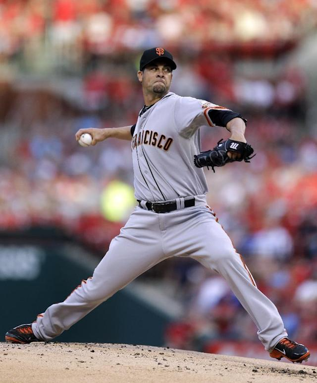 San Francisco Giants starting pitcher Ryan Vogelsong throws during the first inning of a baseball game against the St. Louis Cardinals, Thursday, May 29, 2014, in St. Louis. (AP Photo/Jeff Roberson)