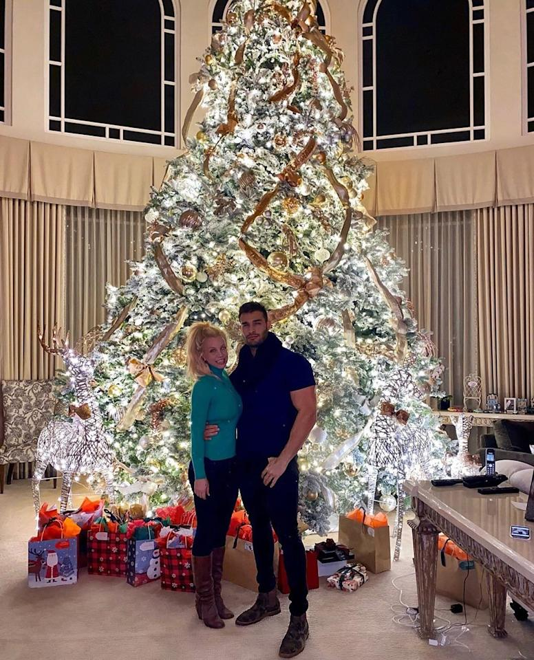It's lit! The Queen of Pop and her longtime love struck a sweet pose while rockin' around their extravagant Christmas tree.
