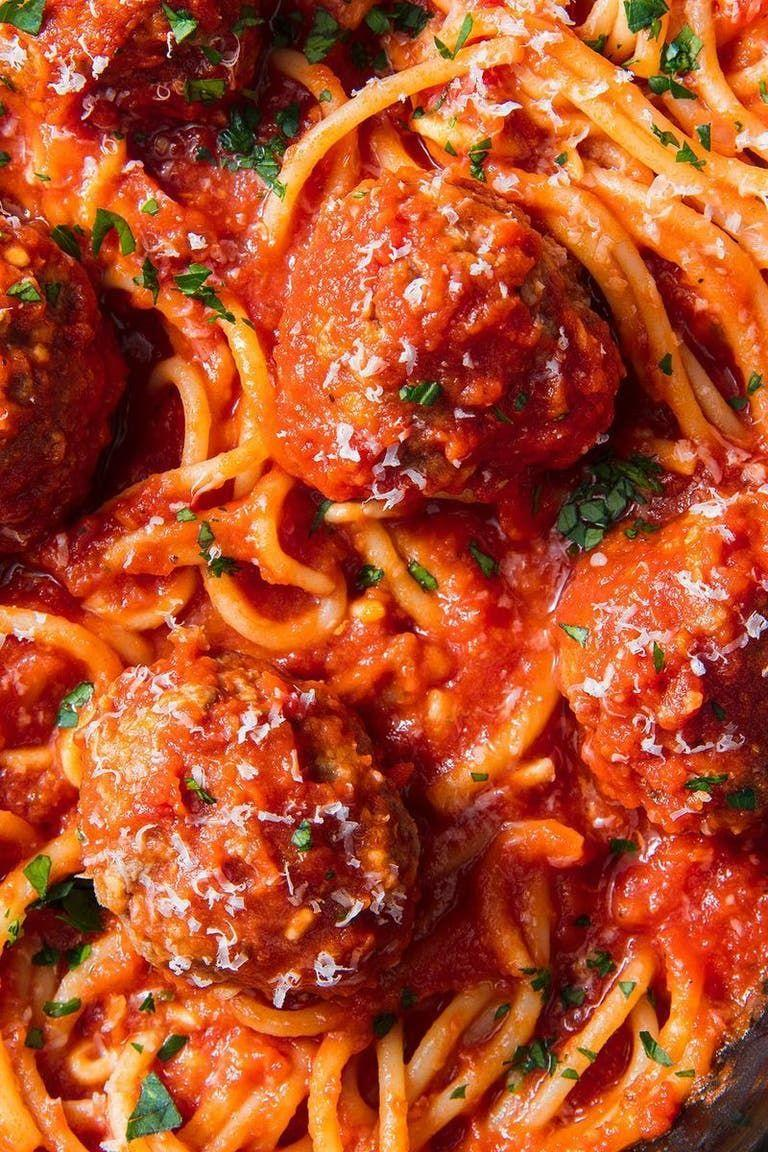 """<p>Spaghetti and meatballs = the ultimate comfort food. It's already no-fuss, but throwing everything into a slow cooker makes it even better and easier!</p><p>Get the <a href=""""https://www.delish.com/uk/cooking/recipes/a30207172/easy-crockpot-spaghetti-recipe/"""" rel=""""nofollow noopener"""" target=""""_blank"""" data-ylk=""""slk:Slow Cooker Spaghetti Meatballs"""" class=""""link rapid-noclick-resp"""">Slow Cooker Spaghetti Meatballs</a> recipe.</p>"""