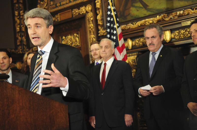 Minneapolis Mayor R.T. Rybak, along with Minnesota Governor Mark Dayton and Vikings' owner Zygi Wilf, speaks during a news conference about a deal reached among legislative leaders for a new Vikings stadium, Thursday, March 1, 2012, at the state capitol in St. Paul, Minn. The plan would put the new building nearly on top of the current Metrodome site. (AP Photo/The St. Paul Pioneer Press,Ben Garvin ) MINNEAPOLIS STAR TRIBUNE OUT