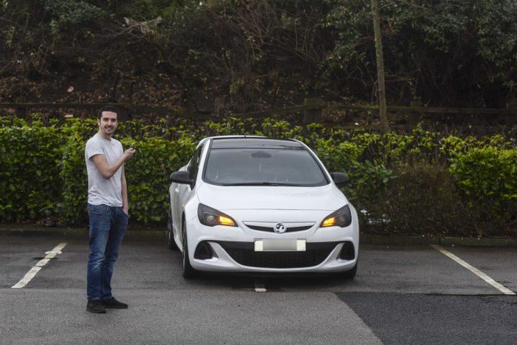 Luke Varley and his 'badly-parked' car (Mercury Press)