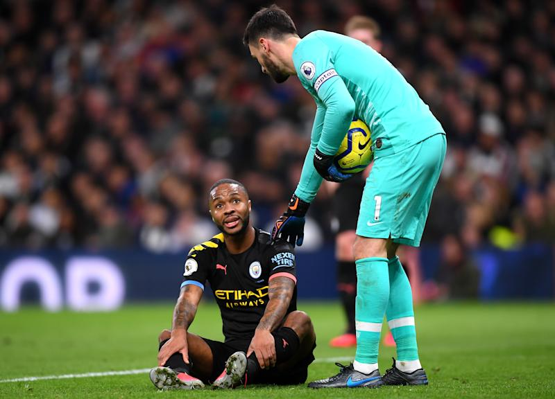 LONDON, ENGLAND - FEBRUARY 02: Hugo Lloris of Tottenham Hotspur consoles Raheem Sterling of Manchester City who reacts before going off injured during the Premier League match between Tottenham Hotspur and Manchester City at Tottenham Hotspur Stadium on February 02, 2020 in London, United Kingdom. (Photo by Laurence Griffiths/Getty Images)
