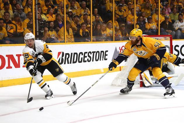 "NASHVILLE, TN – JUNE 05: Josh Archibald #45 of the <a class=""link rapid-noclick-resp"" href=""/nhl/teams/pit/"" data-ylk=""slk:Pittsburgh Penguins"">Pittsburgh Penguins</a> is defended by <a class=""link rapid-noclick-resp"" href=""/nhl/players/4881/"" data-ylk=""slk:Matt Irwin"">Matt Irwin</a> #52 of the <a class=""link rapid-noclick-resp"" href=""/nhl/teams/nas/"" data-ylk=""slk:Nashville Predators"">Nashville Predators</a> during the first period of Game Four of the 2017 NHL Stanley Cup Final at the Bridgestone Arena on June 5, 2017 in Nashville, Tennessee. (Photo by Frederick Breedon/Getty Images)"