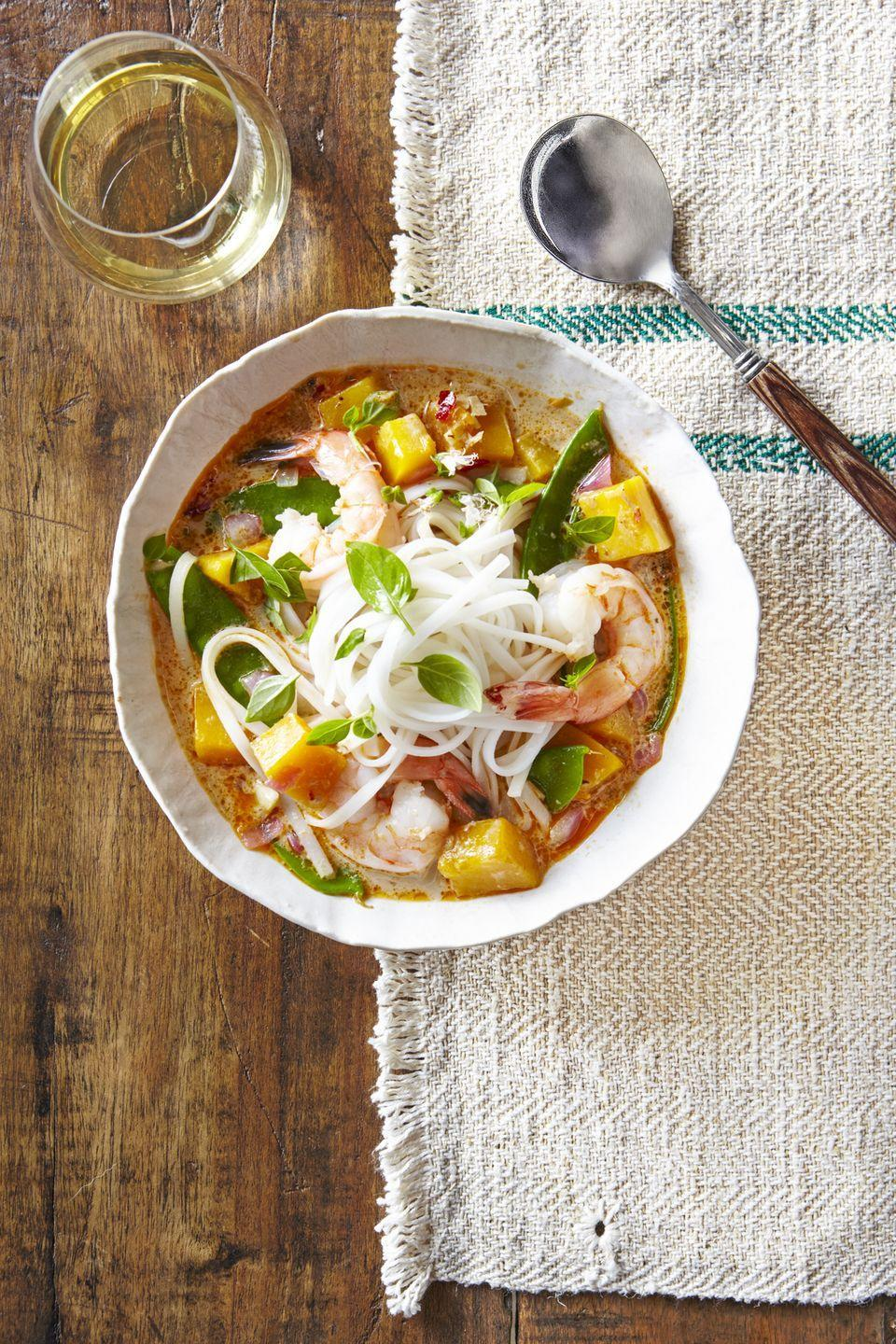 """<p>This tasty <a href=""""https://www.countryliving.com/food-drinks/g3569/fall-soups/"""" rel=""""nofollow noopener"""" target=""""_blank"""" data-ylk=""""slk:fall soup"""" class=""""link rapid-noclick-resp"""">fall soup</a> can be made in under 25 minutes.</p><p><strong><a href=""""https://www.countryliving.com/food-drinks/recipes/a39827/thai-noodle-soup-with-shrimp-pumpkin-recipe/"""" rel=""""nofollow noopener"""" target=""""_blank"""" data-ylk=""""slk:Get the recipe"""" class=""""link rapid-noclick-resp"""">Get the recipe</a>.</strong></p>"""