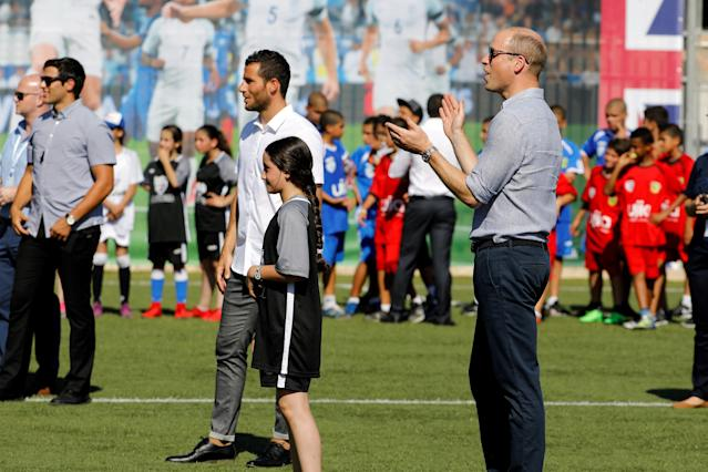 Britain's Prince William stands next to Tomer Hemed, an Israeli professional footballer who plays as a striker for English Premier League club Brighton & Hove Albion during a soccer event with Jewish, Muslim and Christian children organized by The Equalizer and Peres Center for Peace in Jaffa, near Tel Aviv, Israel, June 26, 2018. REUTERS/Amir Cohen