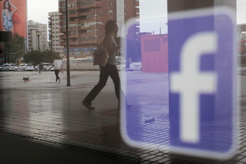 FILE PHOTO: Facebook logo is seen on a shop window in Malaga