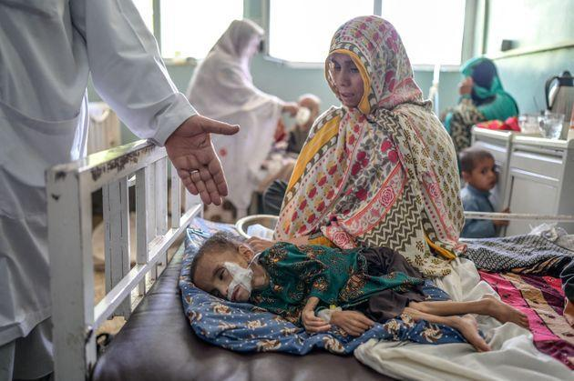 TOPSHOT - A child suffering from malnutrition receives treatment at the Mirwais hospital in Kandahar on September 27, 2021. - At an overcrowded hospital in Kandahar, the few remaining doctors and nurses try urgently to treat skeletal babies and malnourished children packed side by side on beds. (Photo by Bulent KILIC / AFP) (Photo by BULENT KILIC/AFP via Getty Images) (Photo: BULENT KILIC via Getty Images)