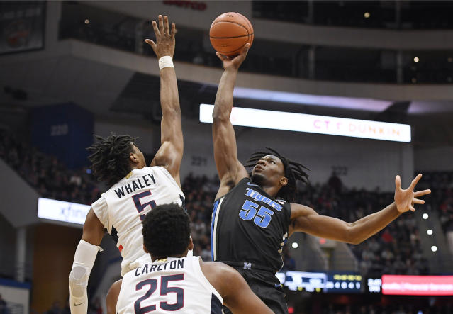 Memphis' Precious Achiuwa (55) shoots over Connecticut's Isaiah Whaley (5) as Connecticut's Josh Carlton (25) defends during the first half of an NCAA college basketball game Sunday, Feb. 16, 2020, in Hartford, Conn. (AP Photo/Jessica Hill)