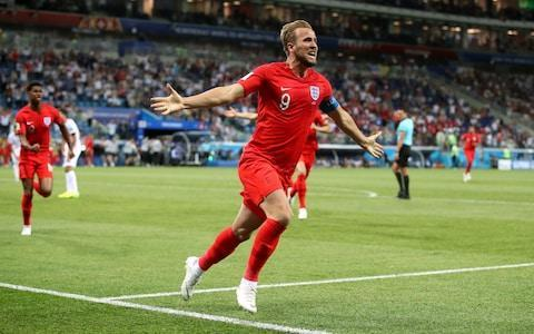 <span>England's Harry Kane celebrates scoring his side's second goal of the game during the FIFA World Cup Group G match</span> <span>Credit: Adam Davy/PA </span>