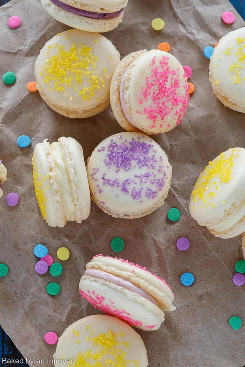 """<p><span>We love the way blogger Jen color-coordinated the sprinkles with the filling flavor.</span></p><p><strong>Get the recipe at <a href=""""http://www.bakedbyanintrovert.com/easter-cheesecake-macarons-recipe/"""" rel=""""nofollow noopener"""" target=""""_blank"""" data-ylk=""""slk:Baked By An Introvert"""" class=""""link rapid-noclick-resp"""">Baked By An Introvert</a>. </strong></p>"""