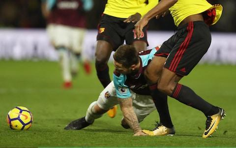 Marko Arnautovic of West Ham United is injured as Marvin Zeegelaar of Watford treads on his hand - Credit: Getty