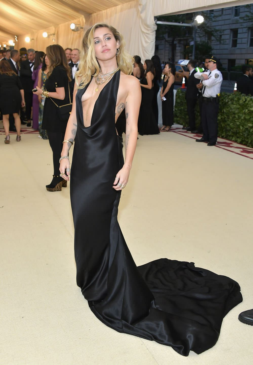 Miley Cyrus\'s Met Gala Dress Dips Dangerously Low [Video]
