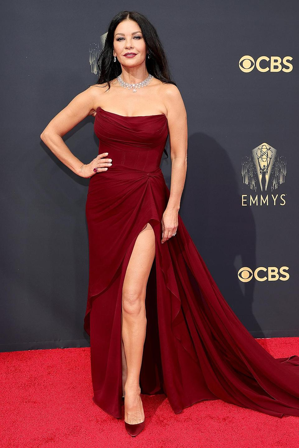 <p>in a strapless maroon ruched gown with thigh-high slit, paired with matching Christian Louboutin pumps and Lorraine Schwartz jewels.</p>