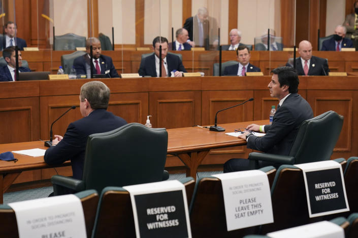 Mauricio Gutierrez, right, President and CEO of NRG, and Kirk Morgan, Vistra chief executive officer, left, answerer questions for the Committees on State Affairs and Energy Resources as they hold a joint public hearing to consider the factors that led to statewide electrical blackouts, Thursday, Feb. 25, 2021, in Austin, Texas. The hearings were the first in Texas since a blackout that was one of the worst in U.S. history, leaving more than 4 million customers without power and heat in subfreezing temperatures. (AP Photo/Eric Gay)