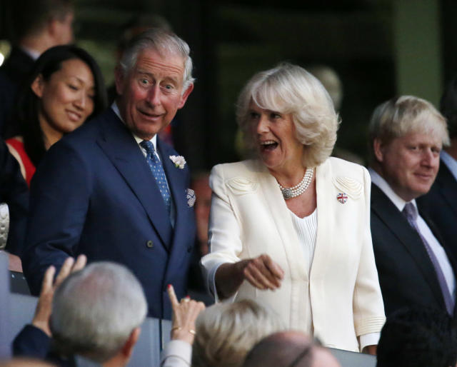 Britain's Prince Charles, left, and his wife Camila, Duchess of Cornwall arrive for the Opening Ceremony at the 2012 Summer Olympics, Friday, July 27, 2012, in London. (AP Photo/Jae C. Hong)