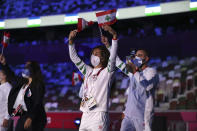 Members of Team Lebanon arrive during the opening ceremony in the Olympic Stadium at the 2020 Summer Olympics, Friday, July 23, 2021, in Tokyo, Japan. (Hannah McKay/Pool Photo via AP)