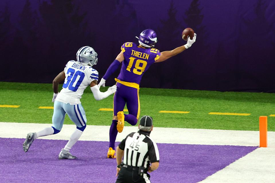 Adam Thielen #19 of the Minnesota Vikings catches a touchdown pass against Anthony Brown #30 of the Dallas Cowboys in the third quarter during their game at U.S. Bank Stadium on November 22, 2020 in Minneapolis, Minnesota. (Photo by Adam Bettcher/Getty Images)
