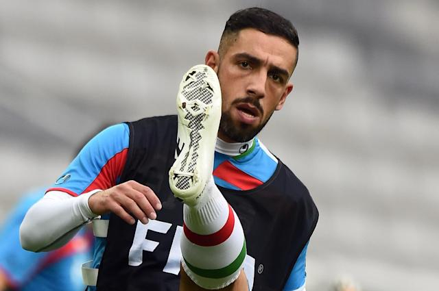 Iran's forward Ashkan Dejagah stretches during a training session at the Baixada Arena in Curitiba, Brazil, on June 15, 2014, during the FIFA World Cup (AFP Photo/Jewel Samad)