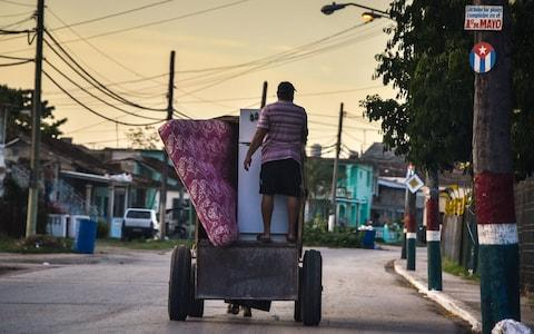 Cubans carry their belongings on September 7, 2017 to protect them from the arrival of Hurricane Irma, in Caibarien, Villa Clara - Credit: ADALBERTO ROQUE/AFP