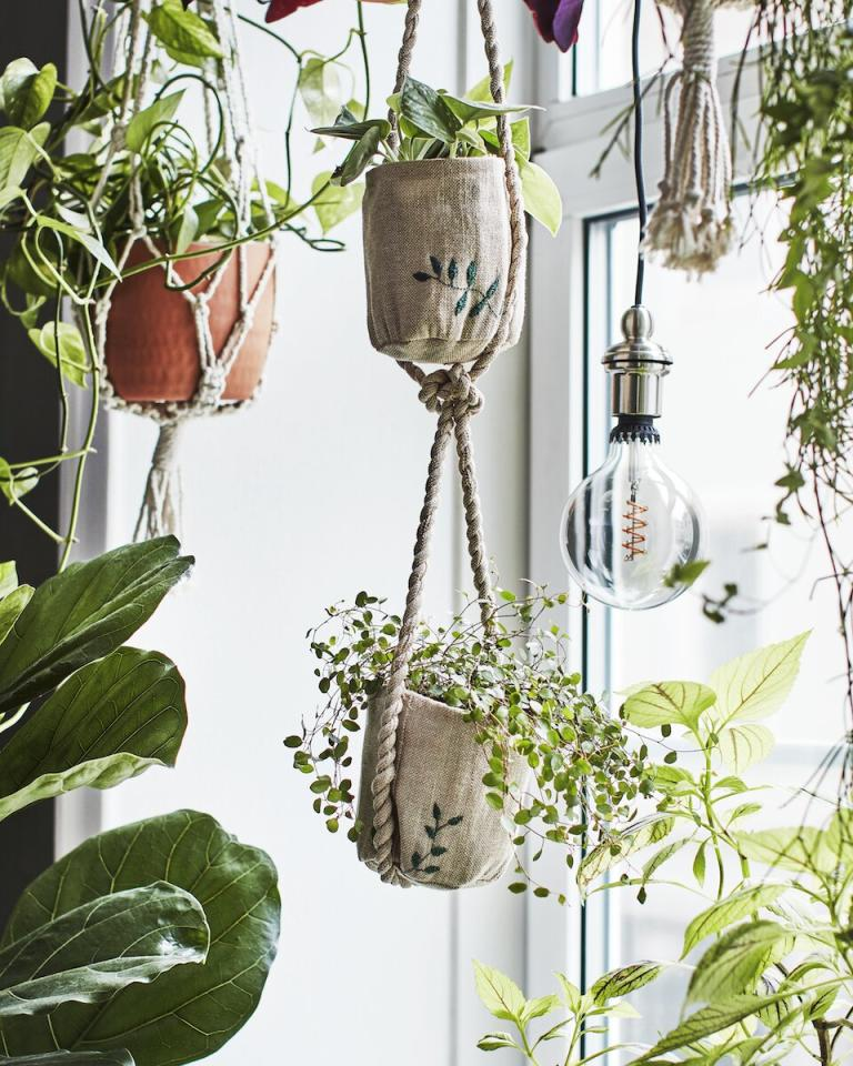 """<p>To turn your home into a lush, plant-filled oasis, incorporate both potted plants that can sit on a side table or stool and hanging plants that maximize vertical space. The new collection includes multiple handcrafted hanging planters, like this one for just $10. </p> <p><strong>To buy: </strong>$10, <a href=""""https://www.ikea.com/us/en/p/botanisk-hanging-planter-beige-handmade-50461310/"""" target=""""_blank"""">ikea.com</a>. </p>"""