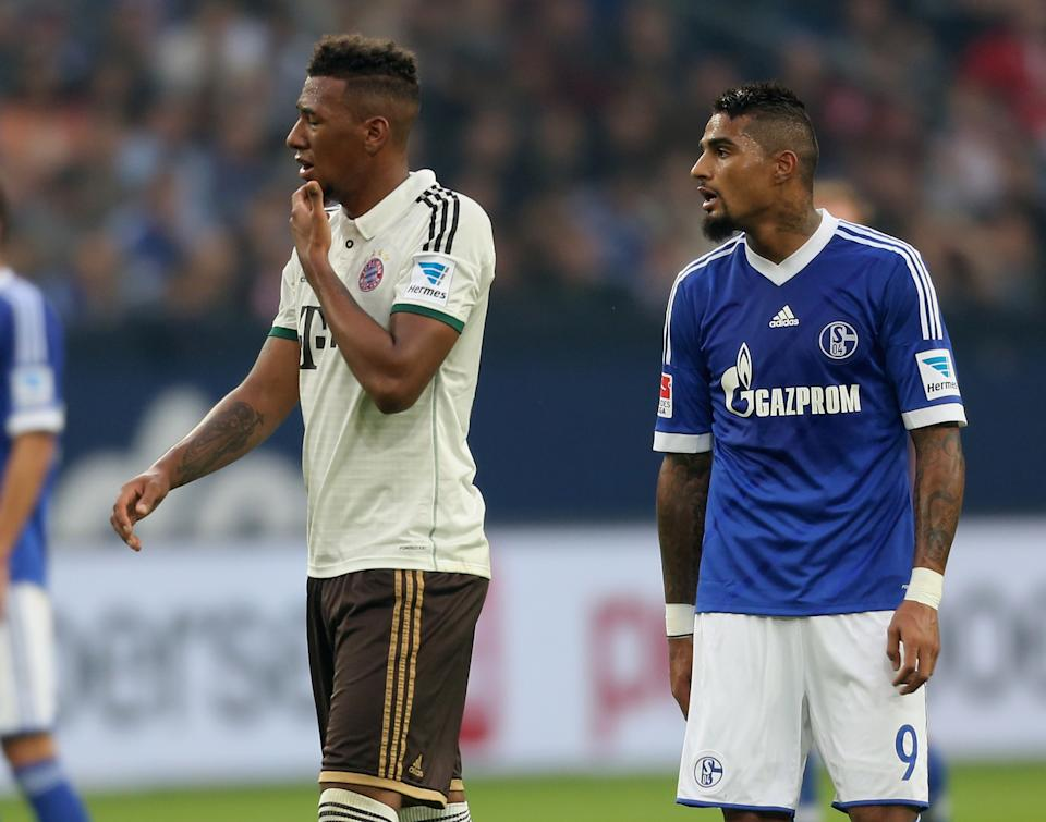 GELSENKIRCHEN, GERMANY - SEPTEMBER 21: Jerome Boateng of Munich (L) stands close to his brother Kevin-Prince Boateng of Schalke during the Bundesliga match between FC Schalke 04 and FC Bayern Muenchen at Veltins-Arena on September 21, 2013 in Gelsenkirchen, Germany.  (Photo by Juergen Schwarz/Bongarts/Getty Images)