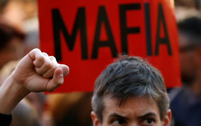 A protester outside the office of the prime minister in Valletta, Malta - REUTERS