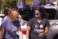 A Supporter of Democratic presidential candidate former Vice President Joe Biden chat before a Ridin' With Biden event Sunday, Oct. 11, 2020, in Plano, Texas. Democrats in Texas are pressing Joe Biden to make a harder run at Texas with less than three weeks until Election Day. (AP Photo/LM Otero)