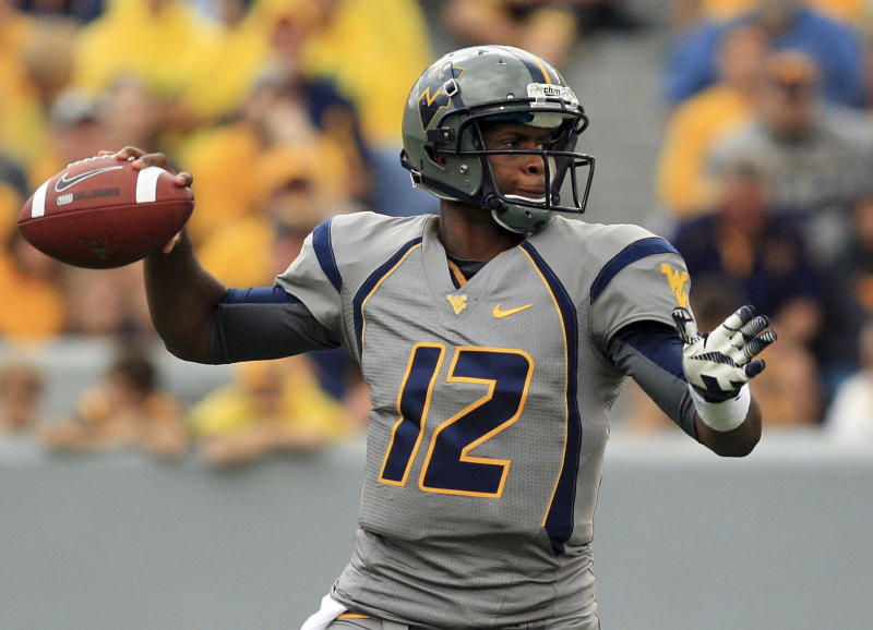 West Virginia quaterback Geno Smith (12) goes to pass during their NCAA college football against Maryland in Morgantown, W.Va. Saturday, Sept. 22, 2012. (AP Photo/Christopher Jackson)