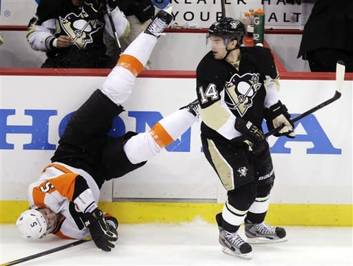Pittsburgh Penguins' Chris Kunitz (14) and Philadelphia Flyers' Braydon Coburn (5) collide in the third period during Game 5 of an opening-round NHL Stanley Cup hockey playoff series in Pittsburgh Friday, April 20, 2012. The Penguins won 3-2. (AP Photo/Gene J. Puskar)