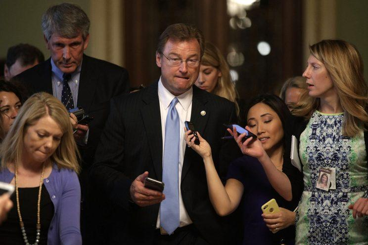 Sen. Dean Heller (R-NV) (C) is surround by members of the media as he is on his way to view the details of a new health care bill July 13, 2017 at the Capitol in Washington, DC. (Photo: Alex Wong/Getty Images)