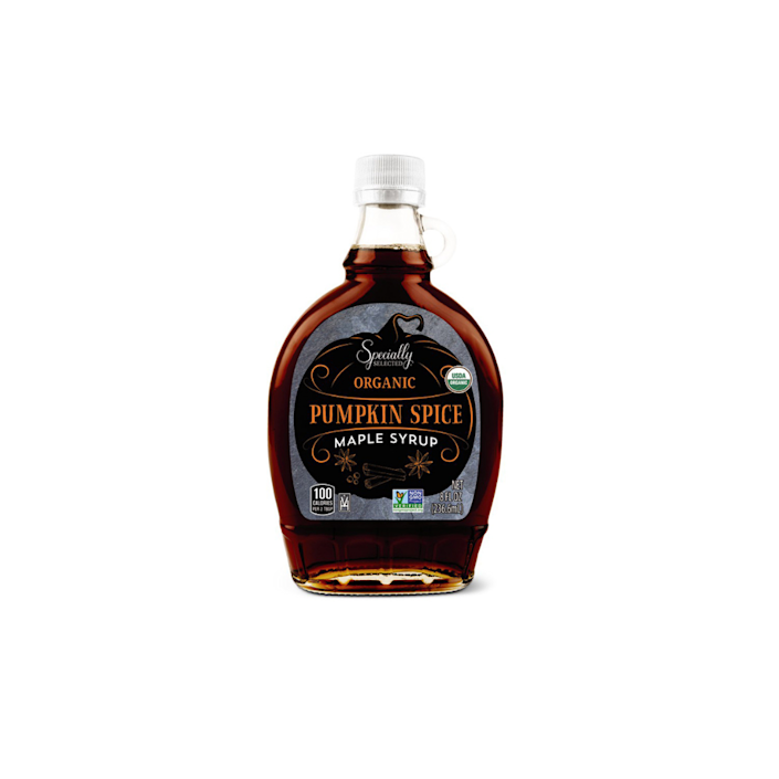 bottle of maple syrup on white