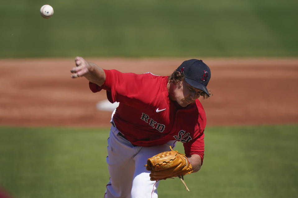 Boston Red Sox starting pitcher Garrett Richards throws in the first inning during a spring training baseball game against the Atlanta Braves on Monday, March 1, 2021, in Fort Myers, Fla. (AP Photo/Brynn Anderson)