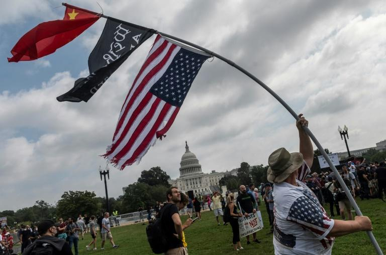 """Demonstrators gather for the """"Justice for J6"""" rally in Washington (AFP/ANDREW CABALLERO-REYNOLDS)"""