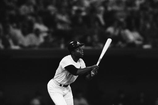FILE - In this April 27, 1971, file photo, Atlanta Braves' Hank Aaron watches as his 600th major league home run during third inning of National League game against San Francisco in Atlanta. Hank Aaron, who endured racist threats with stoic dignity during his pursuit of Babe Ruth but went on to break the career home run record in the pre-steroids era, died early Friday, Jan. 22, 2021. He was 86. The Atlanta Braves said Aaron died peacefully in his sleep. No cause of death was given. (AP Photo/Jack Harris, File)