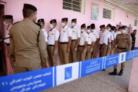 Security forces gather to vote during a special voting ahead of Sunday's parliamentary election in Baghdad, Iraq, Friday, Oct. 8, 2021. (AP Photo/Hadi Mizban)