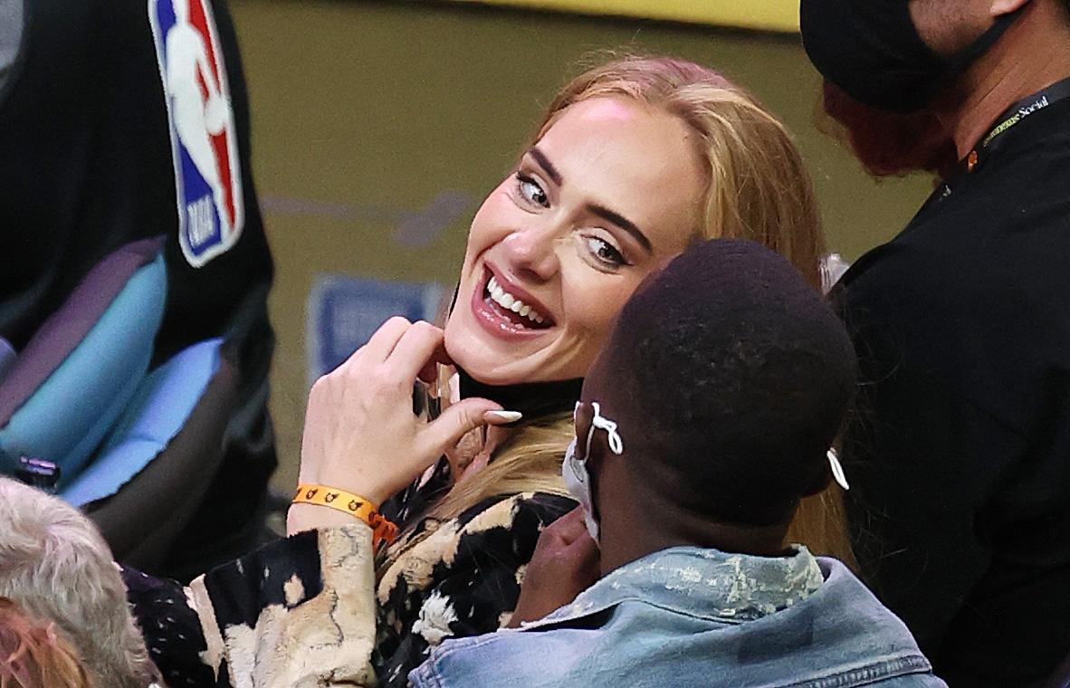 PHOENIX, ARIZONA - JULY 17: Singer Adele smiles with Rich Paul during the second half in Game Five of the NBA Finals between the Milwaukee Bucks and the Phoenix Suns at Footprint Center on July 17, 2021 in Phoenix, Arizona. NOTE TO USER: User expressly acknowledges and agrees that, by downloading and or using this photograph, User is consenting to the terms and conditions of the Getty Images License Agreement.  (Photo by Ronald Martinez/Getty Images)