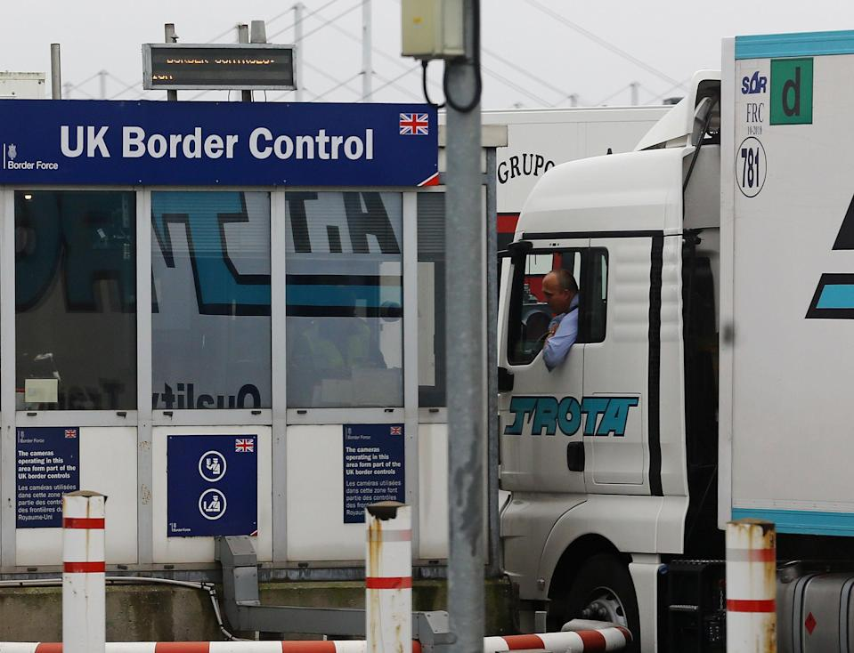 <p>A lorry passes through UK Border Control</p> (PA Archive/PA Images)