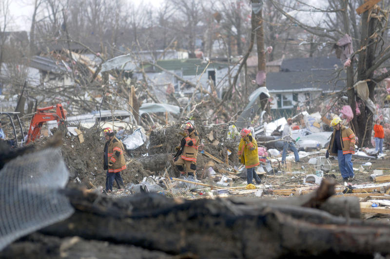 Emergency crews comb through some of the damage after a severe storm hit in the early morning hours on Wednesday, Feb. 29, 2012, in Harrisrbug, Ill. A severe pre-dawn storm pounded portions of southern Illinois on Wednesday. Several deaths have been reported in Harrisburg and left the city's medical center scrambling to treat an influx of injured, the hospital's top administrator said. (AP Photo/The Southern Illinoisan,Paul Newton )
